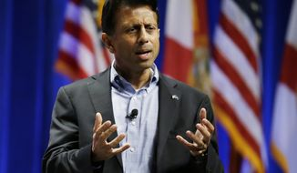 Republican presidential candidate Louisiana Gov. Bobby Jindal, addresses the Sunshine Summit in Orlando, Fla., Saturday, Nov. 14, 2015. (AP Photo/John Raoux)