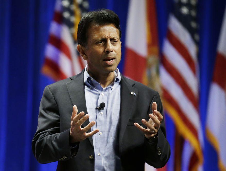 Republican presidential candidate Louisiana Gov. Bobby Jindal, addresses the Sunshine Summit in Orlando, Fla., Saturday, Nov. 14, 2015. (AP Photo/John Raoux)