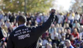 A member of the black student protest group Concerned Student 1950 gestures while addressing a crowd following the announcement that University of Missouri System President Tim Wolfe would resign, at the university in Columbia, Mo., in this Nov. 9, 2015, file photo. (AP Photo/Jeff Roberson, File)