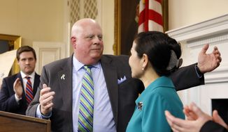 Maryland Gov. Larry Hogan, left, turns to his wife Yumi for a hug during a news conference to announce that his cancer is in complete remission, Monday, Nov. 16, 2015, in Annapolis, Md. Hogan, who was diagnosed with B-cell non-Hodgkin lymphoma in June, will continue to get scans on a regular basis and undergo preventive health maintenance. (AP Photo/Patrick Semansky)
