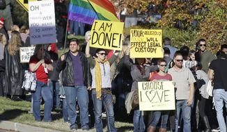 People gather for a mass resignation from the Church of Jesus Christ of Latter-day Saints Saturday, Nov. 14, 2015, in Salt Lake City. A day after the Mormon church stood behind its new rules targeting gay members and their children, while issuing clarifications, hundreds held a rally in Salt Lake City to protest their displeasure with the policy changes. (AP Photo/Rick Bowmer)
