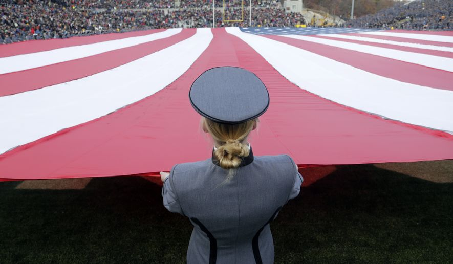 Cadets hold an American flag on the field during halftime on Military Appreciation Day during an NCAA college football game between Army and Tulane on Saturday, Nov. 14, 2015, in West Point, N.Y. Tulane won 34-31. (AP Photo/Mike Groll)