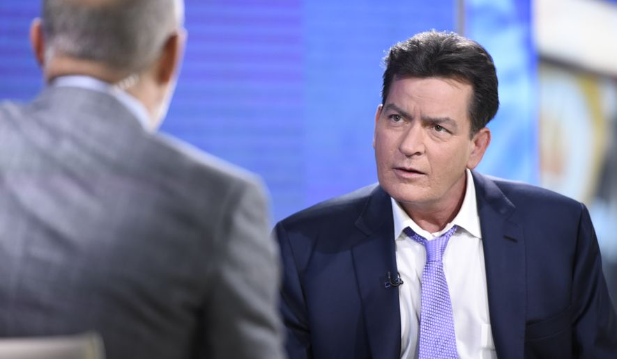 """Former """"Two and a Half Men"""" star Charlie Sheen, right, is interviewed by Matt Lauer, Tuesday, Nov. 17, 2015 on NBC's """"Today"""" in New York. In the interview, the 50-year-old Sheen said he tested positive four years ago for the virus that causes AIDS. (Peter Kramer/NBC via AP)"""