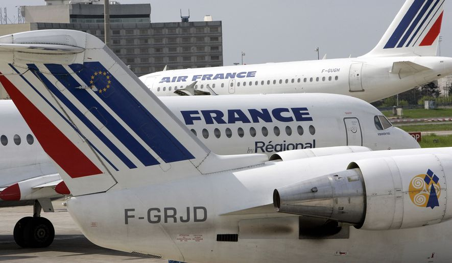 Air France planes are parked at Roissiy-Charles de Gaulle airport, north of Paris. (Associated Press)
