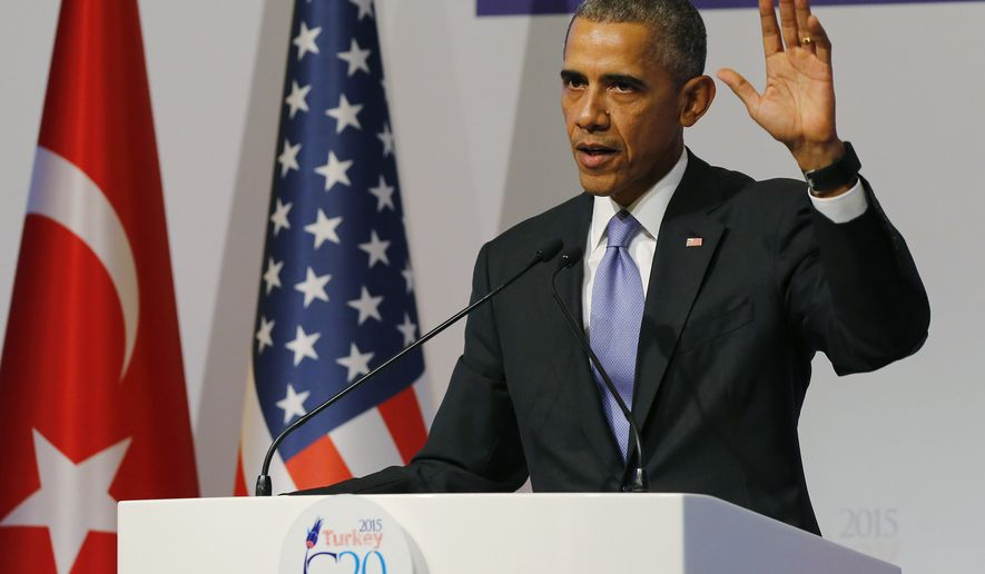 U.S. President Barack Obama gestures to journalists following a news conference at the end of the G-20 summit in Antalya, Turkey, Monday, Nov. 16, 2015. The Paris terror attacks have sparked widespread calls from congressional Republicans to end or limit U.S. refugee admissions from Syria, with some threatening to use critical spending legislation as leverage weeks from a must-pass deadline. That could allow Republicans to block Obama's goal of bringing 10,000 more Syrian refugees to the U.S. during this budget year.  (Anadolu Agency via AP, Pool)