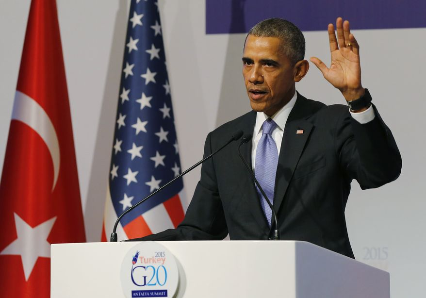 U.S. President Barack Obama gestures to journalists following a news conference at the end of the G-20 summit in Antalya, Turkey, Monday, Nov. 16, 2015. The leaders of the Group of 20 wrapped up their two-day summit near the Turkish Mediterranean coastal city of Antalya Monday against the backdrop of heavy French bombardment of the Islamic State's stronghold in Syria. The bombings marked a significant escalation of France's role in the fight against the extremist group. (Anadolu Agency via AP, Pool)