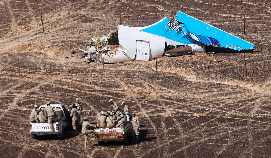 In this Sunday, Nov. 1, 2015, file photo provided by Russian Emergency Situations Ministry, Egyptian Military on cars approach a plane's tail at the wreckage of a passenger jet bound for St. Petersburg in Russia that crashed in Hassana, Egypt. (Maxim Grigoriev/Russian Ministry for Emergency Situations via AP, File)
