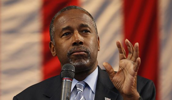 Republican presidential candidate Ben Carson speaks at a rally Sunday, Nov. 15, 2015, in Henderson, Nev. Carson spoke at a church in Las Vegas earlier in the day before speaking to a crowd at the rally in Henderson, Nev. (AP Photo/John Locher)