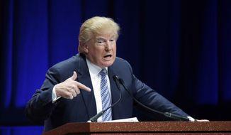 Republican presidential candidate Donald Trump addresses the Sunshine Summit in Orlando, Fla., in this Nov. 13, 2015, file photo. (AP Photo/John Raoux)