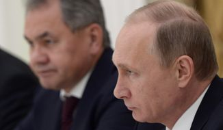 Russian President Vladimir Putin, right, flanked by Defense Minister Sergei Shoigu, meets with Vice Chairman of China's Central Military Commission Xu Qiliang in the Kremlin in Moscow, Tuesday, Nov. 17, 2015. (Alexei Nikolsky/SPUTNIK, Kremlin Pool Photo via AP)