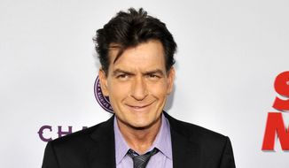 "Charlie Sheen, a cast member in ""Scary Movie V,"" poses at the Los Angeles premiere of the film at the Cinerama Dome in Los Angeles in this April 11, 2013, file photo. (Photo by Chris Pizzello/Invision/AP, file)"