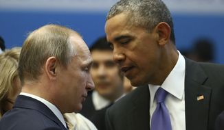 U.S. President Barack Obama , right, talks with Russian President Vladimir Putin, left, prior to a session of the G-20 Summit in Antalya, Turkey, Monday, Nov. 16, 2015. The leaders of the Group of 20 were wrapping up their two-day summit in Turkey Monday against the backdrop of heavy French bombardment of the Islamic State's stronghold in Syria. The bombings marked a significant escalation of France's role in the fight against the extremist group. (Kayhan Ozer/Anadolu Agency via AP, Pool)