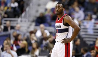 Washington Wizards guard John Wall (2) pauses in the first half of an NBA basketball game against the Milwaukee Bucks, Tuesday, Nov. 17, 2015, in Washington. (AP Photo/Alex Brandon)