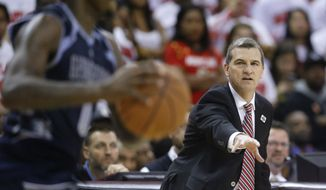 Maryland head coach Mark Turgeon directs his players during an NCAA college basketball game against Georgetown, Tuesday, Nov. 17, 2015, in College Park, Md. (AP Photo/Patrick Semansky)