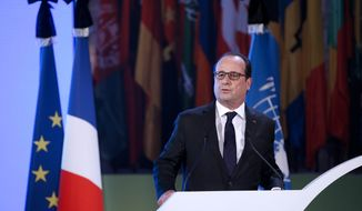 """French President Francois Hollande delivers a speech for the 70th General Conference of the United Nations Educational, Scientific and Cultural Organization (UNESCO) at the UNESCO headquarters in Paris, Tuesday, Nov. 17 2015. France earlier invoked a never-before-used European Union """"mutual-defense clause"""" to demand Tuesday that its partners provide support for its operations against the Islamic State group in Syria and Iraq and other security missions in the wake of the Paris attacks. (Yoan Valat, Pool photo via AP)"""