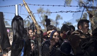 People wait in line to enter the migrant and refugee registration camp in Moria, on the island of Lesbos, Greece, in this Nov. 4, 2015, file photo. (AP Photo/Marko Drobnjakovic, File)