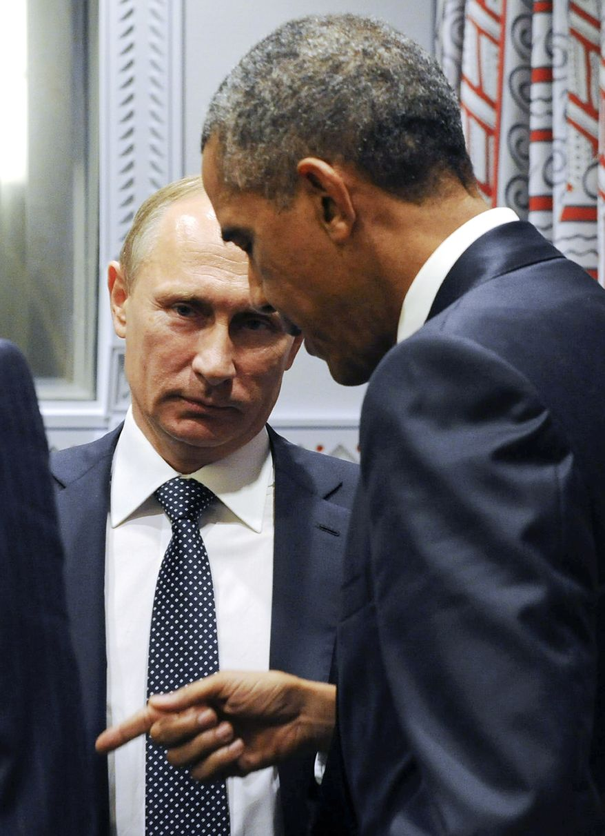 President Obama speaks with Russian President Vladimir Putin before a bilateral meeting at United Nations headquarters in New York, Monday, Sept. 28, 2015. (Associated Press)