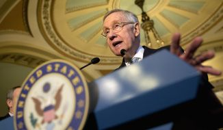 Senate Minority Leader Harry Reid of Nev., accompanied by the Senate Democratic leadership, speaks during a news conference on Capitol Hill in Washington, Tuesday, Nov. 17, 2015. (AP Photo/Jacquelyn Martin)