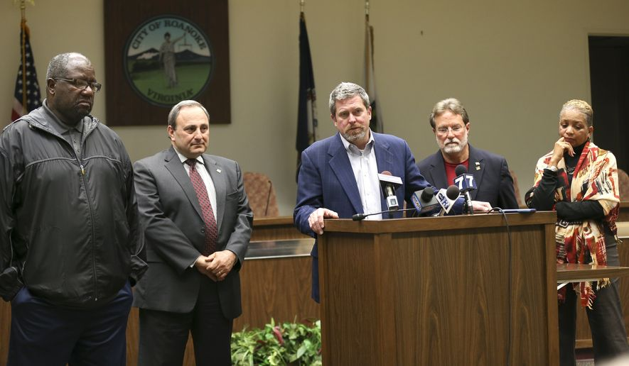 Roanoke, Virginia, Vice Mayor David B. Trinkle (center), joined by council members (from left) Sherman Lea, William D. Bestpitch, Raphael E. Ferris and Anita J. Price, speaks at a news conference Wednesday to denounce comments that Mayor David Bowers made about Syrian refugees. (Associated Press)