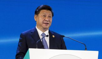 In this photo provided by China's Xinhua News Agency, Chinese President Xi Jinping addresses the audience at the Asia-Pacific Economic Cooperation (APEC) CEO summit in Manila, the Philippines, Nov. 18, 2015. Chinese President Xi on Wednesday sought to reassure regional economic and political leaders that his government will keep the world's No. 2 economy growing.(Li Xueren/Xinhua via AP)