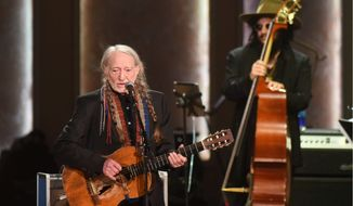 Willie Nelson performed after being presented with the 2015 Library of Congress Gershwin Prize for Popular Song. (Associated Press)