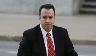 Former Subway pitchman Jared Fogle arrives at the federal courthouse in Indianapolis, Thursday, Nov. 19, 2015. Fogle is due to formally plead guilty and be sentenced on charges of trading child pornography and paying for sex with minors. (AP Photo/Michael Conroy)