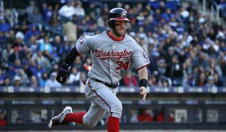 Washington Nationals' Bryce Harper, trying for the National League batting title, runs out a ground ball in the seventh inning of a baseball game in New York, Sunday, Oct. 4, 2015. (AP Photo/Kathy Willens)