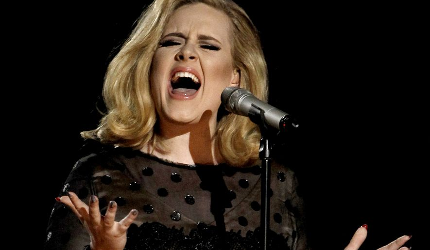"""FILE - In this Feb. 12, 2012 file photo, Adele performs during the 54th annual Grammy Awards in Los Angeles. The singer's hotly anticipated new album, """"25,"""" is out Friday, Nov. 20, 2015. (AP Photo/Matt Sayles, File)"""