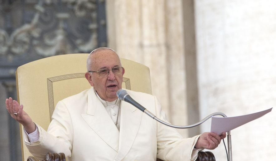Pope Francis delivers his speech during the weekly general audience he held in St. Peter's Square, at the Vatican,  Wednesday, Nov. 18, 2015. (AP Photo/Andrew Medichini) ** FILE **