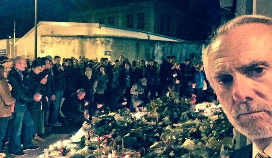 The Rev. Bill Devlin, an American pastor, and Parisians following the Nov. 13, 2015, terror attacks. (Photo courtesy Bill Devlin)