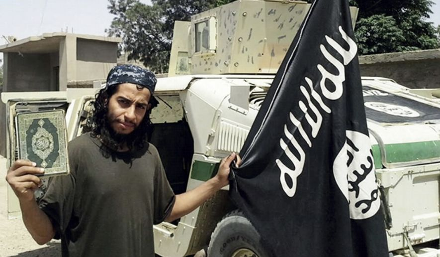This undated image made available in the Islamic State's English-language magazine Dabiq, shows Belgian Abdelhamid Abaaoud. . Abaaoud the Belgian jihadi suspected of masterminding deadly attacks in Paris was killed in a police raid on a suburban apartment building, the city prosecutor's office announced Thursday Nov. 1, 2015. Paris Prosecutor Francois Molins' office said 27-year-old Abdelhamid Abaaoud was identified based on skin samples. His body was found in the apartment building targeted in the chaotic and bloody raid in the Paris suburb of Saint-Denis on Wednesday. (Militant photo via AP)