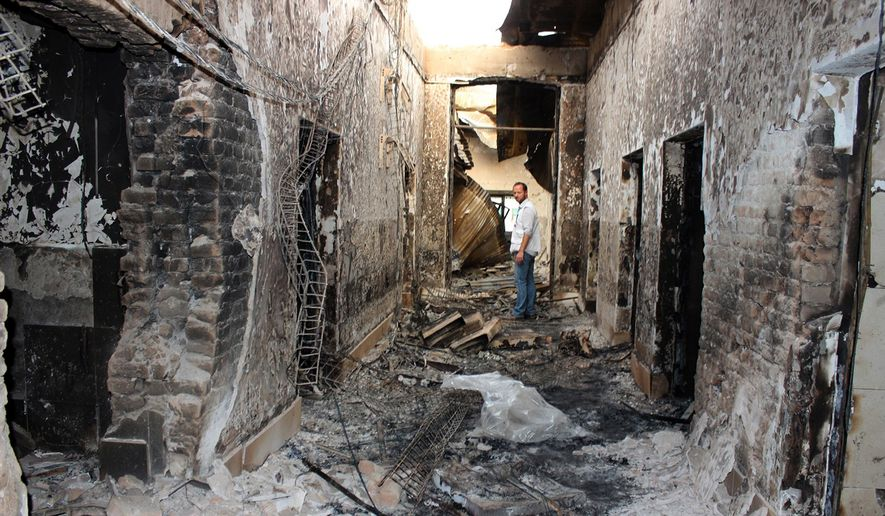 An employee of Doctors Without Borders stands inside the charred remains of their hospital after it was hit by a U.S. airstrike in Kunduz, Afghanistan, in this Oct. 16, 2015, file photo. (Najim Rahim via AP, File)