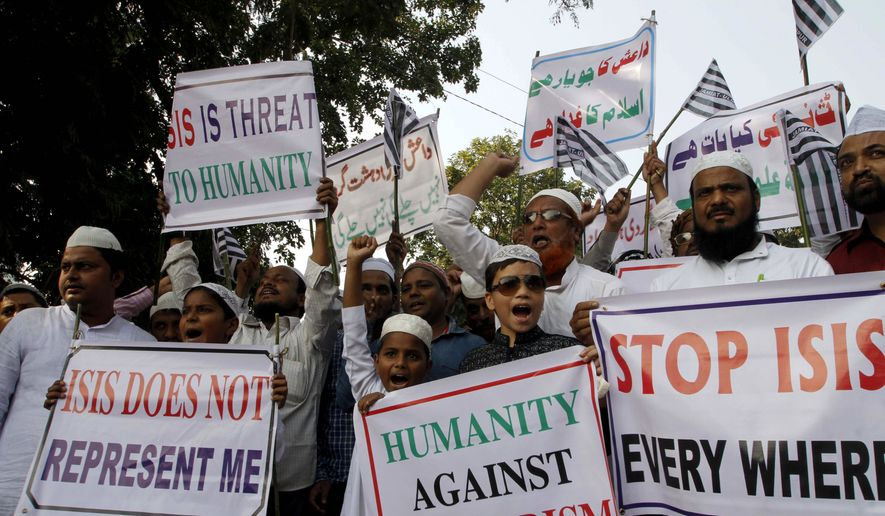 Indian Muslims shout slogans during a protest against ISIS, an Islamic State group, and the Nov. 13 attacks in Paris, in the eastern Indian city of Bhubaneswar, Friday, Nov. 20, 2015. Multiple attacks across Paris last Friday night left 130 dead and many more injured. (AP Photo/Biswaranjan Rout)