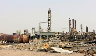 This Oct. 22, 2015 file photo shows destruction at Beiji oil refinery during the military operations, some 250 kilometers (155 miles) north of Baghdad, Iraq. The United States and Russia are going after the Islamic State's oil industry, destroying refineries and hundreds of tanker trucks transporting oil from eastern Syria in a heavy bombardment in recent days aiming to break the extremists' biggest source of income.  (AP Photo/File)