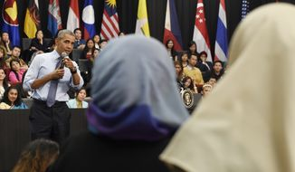 President Barack Obama calls on an audience member to ask him a question during the Young Southeast Asian Leaders Initiative (YSEALI) town hall at Taylor's University in Kuala Lumpur, Malaysia, Friday, Nov. 20, 2015. (AP Photo/Susan Walsh)