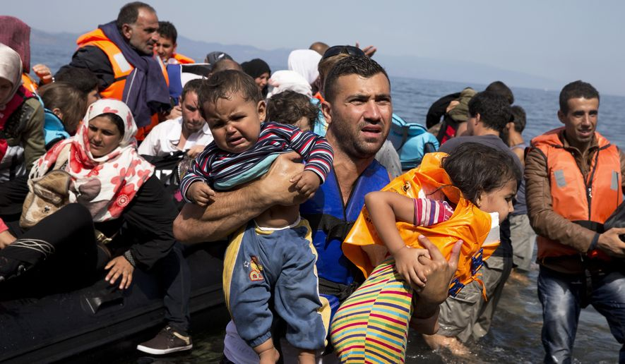 In this Sept. 10, 2015, file photo, Syrian refugees arrive aboard a dinghy after crossing from Turkey to the island of Lesbos, Greece. (AP Photo/Petros Giannakouris, File)