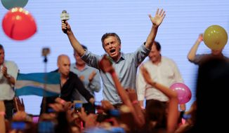 "A highly emotional Mauricio Macri danced and sang to chants of ""Argentina, Argentina"" and ""Yes, we can"" from the crowd gathered at his victory rally. Accompanied by leaders of his Cambiemos coalition of both center-left and center-right forces, he reiterated his key campaign promises of eliminating poverty and fighting the drug trade. (Associated Press)"