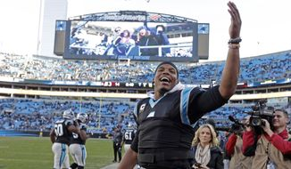 Carolina Panthers' Cam Newton (1) celebrates on the sidelines in the second half of an NFL football game against the Washington Redskins in Charlotte, N.C., Sunday, Nov. 22, 2015. The Panthers won 44-16. (AP Photo/Chuck Burton)