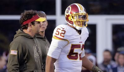 Washington Redskins linebacker Keenan Robinson leaves the field after an injury during the second half of an NFL football game against the New England Patriots, Sunday, Nov. 8, 2015, in Foxborough, Mass. (AP Photo/Steven Senne)