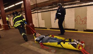 In an abandoned subway station in a lower Manhattan, emergency responders stage a drill simulating a terrorist attack Sunday, Nov. 22, 2015, in New York.  Following the Nov. 13 terror attack in Paris and four days before New York's Macy's Thanksgiving Day Parade, members of the NYPD, Fire Deptartment of New York and Homeland Security participated in the drill. (New York Police Department via AP)