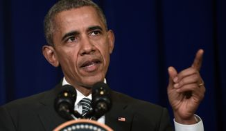 President Barack Obama speaks at a news conference in Kuala Lumpur, Malaysia, Sunday, Nov. 22, 2015. In Southeast Asia, Obama has taken a softer tone on human rights and corruption in a part of the world that rights groups claim is rife with abuses. (AP Photo/Susan Walsh)