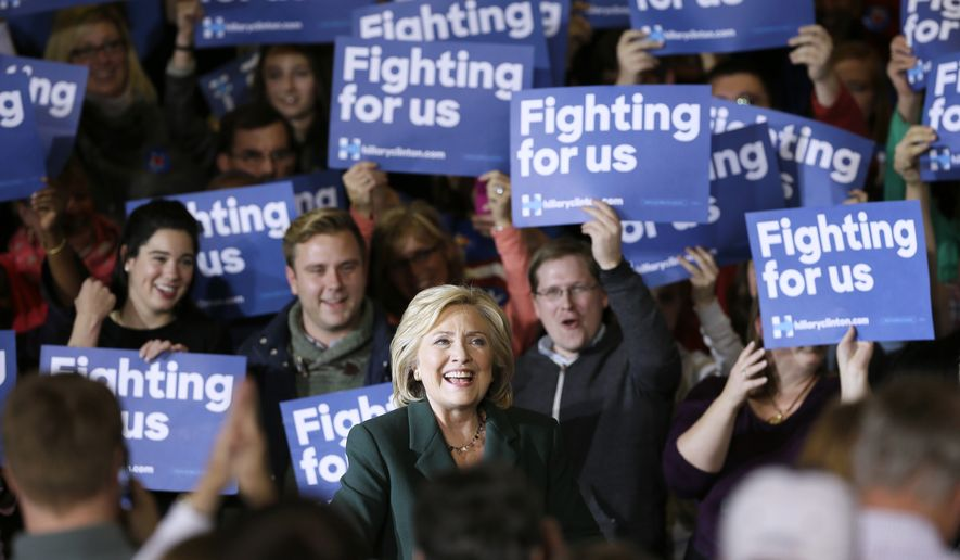 Democratic presidential candidate Hillary Rodham Clinton smiles as she arrives to speak at a town hall meeting Sunday, Nov. 22, 2015, in Clinton, Iowa. (AP Photo/Charlie Neibergall)
