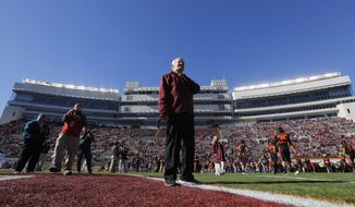 Virginia Tech head coach Frank Beamer looks around the field prior to an NCAA college football game in Blacksburg, Va., Saturday, Nov. 21, 2015. It is the last home game for Tech coach Frank Beamer who has announced his retirement. (AP Photo/Steve Helber)