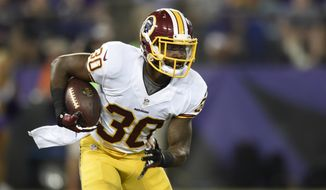 Washington Redskins strong safety Kyshoen Jarrett rushes the ball in the second half of a preseason NFL football game against the Baltimore Ravens, Saturday, Aug. 29, 2015, in Baltimore. (AP Photo/Gail Burton)