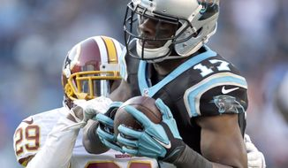 Washington Redskins' Chris Culliver (29) tries to break up a pass caught by Carolina Panthers' Devin Funchess (17) during the second half of an NFL football game in Charlotte, N.C., Sunday, Nov. 22, 2015. The Panthers won 44-16. (AP Photo/Bob Leverone)