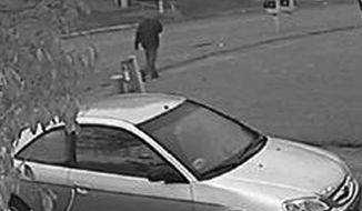 This frame grab from surveillance video provided by the Indianapolis Metropolitan Police Department shows a possible suspect walking in the neighborhood where an Indianapolis pastor's wife was shot. Police say Amanda Blackburn, 28, was shot in the head during an attack in her home on Nov. 10, 2015 and died the next day. She was 13 weeks pregnant. (Indianapolis Metropolitan Police Department via AP)