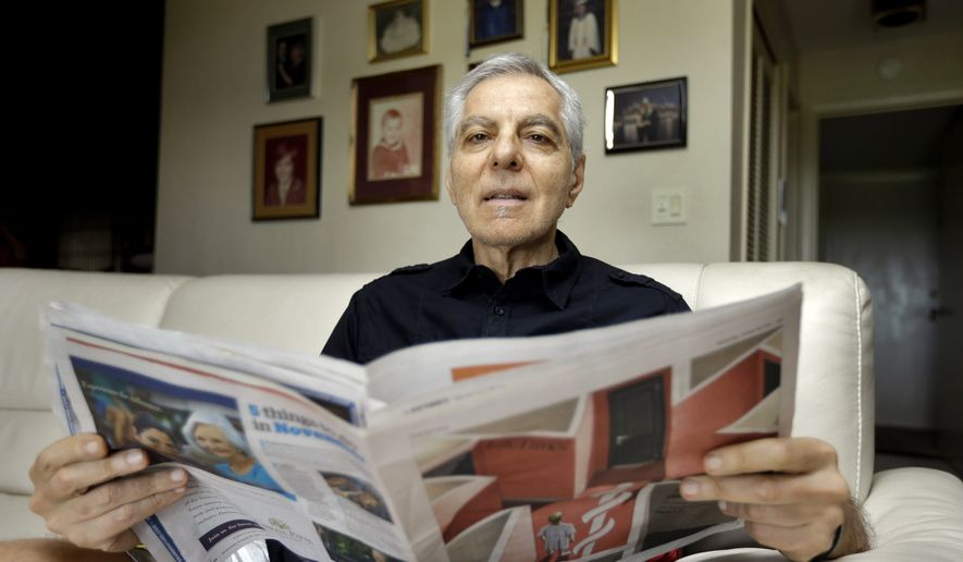 Sal Natale looks over a Medicare brochure at his home in Seminole, Fla., in this Nov. 17, 2015, file photo. (AP Photo/Chris O'Meara)