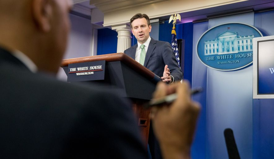 White House press secretary Josh Earnest answers a question from members of the media at the daily press briefing at the White House in Washington on Nov. 23, 2015. (Associated Press) **FILE**