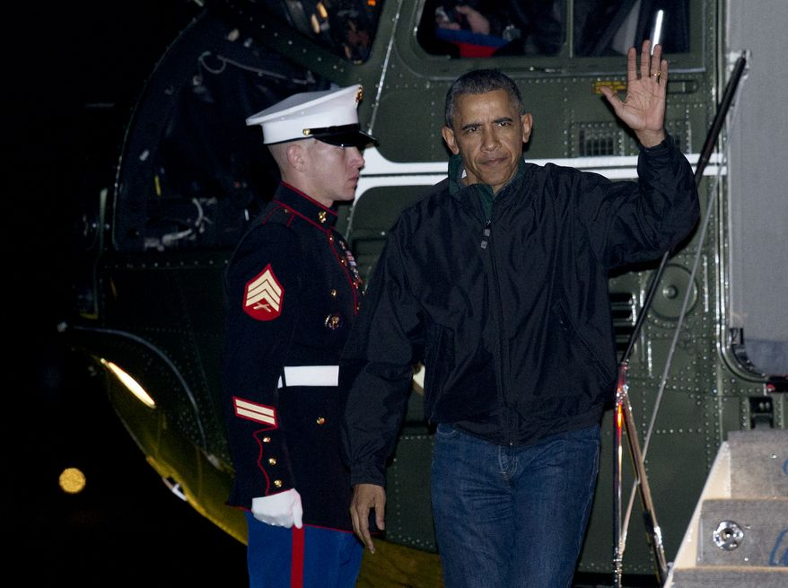 President Barack Obama waves as he arrives at the White House in Washington, Monday, Nov. 23, 2015, from a nine-day trip to Turkey, Philippines and Malaysia.  (AP Photo/Manuel Balce Ceneta)