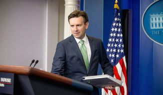 White House press secretary Josh Earnest arrives for the daily press briefing at the White House in Washington, Monday, Nov. 23, 2015. Earnest discussed the Islamic State group, the attacks in Paris, and other topics. (AP Photo/Andrew Harnik)